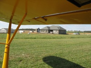 A new home, seen from the cockpit of Mark Scheibe's PA-11 Cub Special that just landed at Mohican Airpark.
