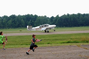 The Bonanza touches down on Portage County Airport's runway 27 as Ron Siwik arrives home.