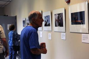 Pilot, Ken Moir enjoys one of the photos in the exhibit.